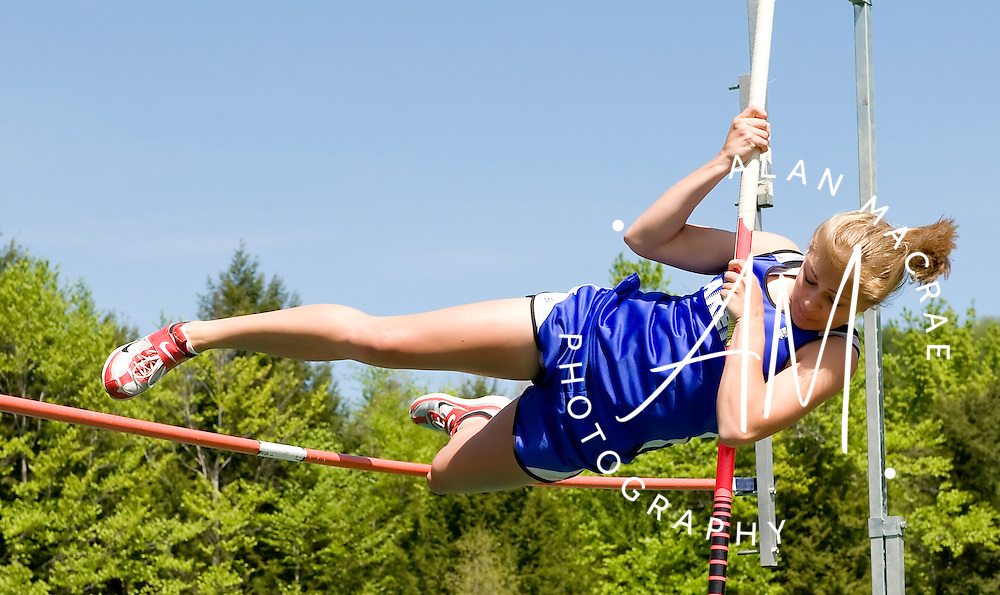 Interlakes senior Danica Goodheart attempts the pole vault during Saturday's meet at Newfound Regional High School in Bristol.  (Alan MacRae/for the Monitor)