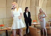 Gwyneth Paltrow, left, Christy Turlington Burns, center, and Tracy Anderson celebrate the launch of the Tracy Anderson Method Pregnancy Project DVD series at The Top of The Standard in New York, Friday, Oct. 5, 2012, in support of Every Mother Counts.  (Photo by Diane Bondareff/Invision for Tracy Anderson Method/AP Images)