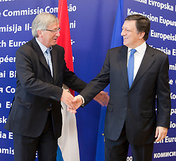 Jean-Claude Juncker, Luxembourg's prime minister and president of the Eurogroup, left, meets with Jose Manuel, Barroso, president of the European Commission, prior to the Eurogroup conference, the meeting of finance ministers from the euro-zone countries, at EU headquarters in Brussels, Monday, July 6, 2009. (Photo © Jock Fistick)