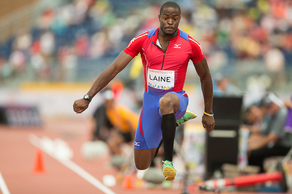 Samyr  Laine of Haiti competes in the men's triple jump at CIBC Athletics Stadium at the 2015 Pan American Games in Toronto, Canada, July 24,  2015.  AFP PHOTO/GEOFF ROBINS