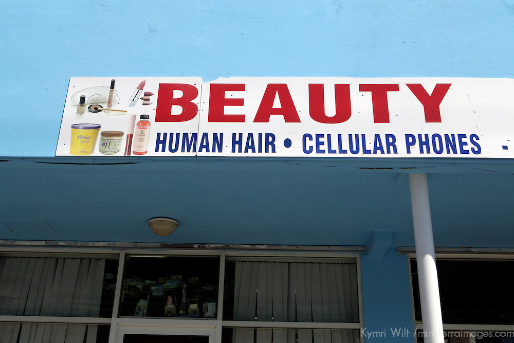 Americas, Caribbean, Antigua & Barbuda. In St. John's, Antigua, this shop sign gives a broad definition of beauty by offering both human hair and cell phones.