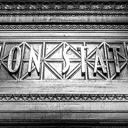Chicago Union Station sign panorama photo in black and white. Panorama photo ratio is 1:3. Union Station opened in 1925 and serves as a train station for commuter trains serving Chicago and the Chicago suburbs.