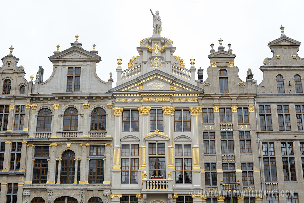 Some of the ornate architecture in the Grand Place, Brussels. Originally the city's central market place, the Grand-Place is now a UNESCO World Heritage site. Ornate buildings line the square, including guildhalls, the Brussels Town Hall, and the Breadhouse, and seven cobbelstone streets feed into it.