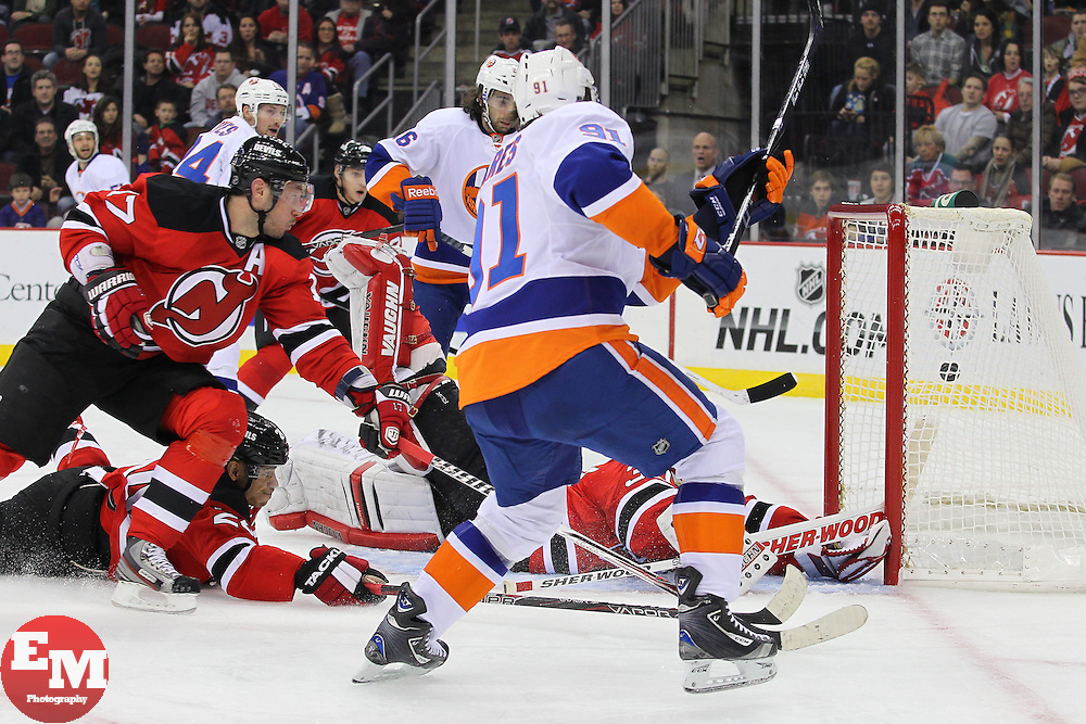 Jan 31, 2013; Newark, NJ, USA; New York Islanders center John Tavares (91) scores a goal past New Jersey Devils goalie Martin Brodeur (30) during the first period at the Prudential Center.