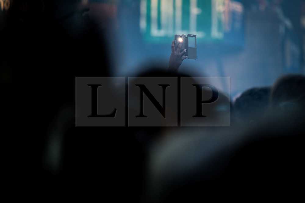 """© Licensed to London News Pictures . 02/07/2015 . Manchester , UK . A single camera phone lifted above the crowd for Paolo Nutini at the Castlefield Bowl at the opening of """" Summer in the City """" festival in Manchester. Photo credit : Joel Goodman/LNP"""