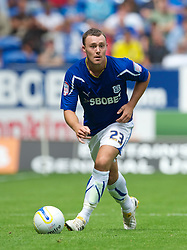 CARDIFF, WALES - Sunday, August 8, 2010: Cardiff City's Welsh international defender Darcy Blake in action against Sheffield United during the League Championship match at the Cardiff City Stadium. (Pic by: David Rawcliffe/Propaganda)
