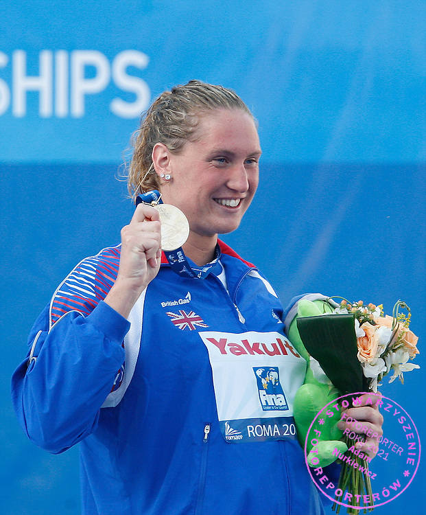 ROME 28/07/2009.13th Fina World Championships.Gold medallist Gemma Spofforth of Britain celebrates on the podium after winning and setting a world record in the women's 100m backstroke swimming final at the World Championships in Rome.photo: Piotr Hawalej / WROFOTO