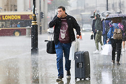 © Licensed to London News Pictures. 27/09/2019. London, UK. A man is seen with a suitcase during heavy downpour in London. According to the Met Office, this weekend is set to be washout with over 2o hours of rainfall in the capital. Photo credit: Dinendra Haria/LNP. Photo credit: Dinendra Haria/LNP