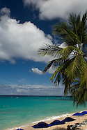 Sun loungers and umbrellas on the beach at Alleynes Bay on the West Coast of<br /> Barbados