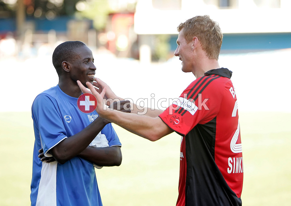 FCZ's Onyekachi Okonkwo (L) aka Tico is talking to Leverkusen's Lukas Sinkiewicz (R)  after a charity soccer game between Swiss FC Zuerich and Germany's Bayer 04 Leverkusen at the Hardturm stadium in Zurich, Switzerland, Saturday 14 July 2007. The charity game is dedicated to FC Zurich supporter Roland Maag who got badly hurt a year ago by unidentified hooligans  after a FC Zurich game. (Photo by Patrick B. Kraemer / MAGICPBK)