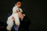 A ma holds his Poddle at the 50th Euro Dog Show in Kortrijk, Belgium, 16 November 2013.