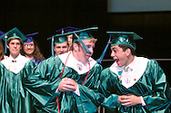 Arriving from opposite ends of the stage, CJ seniors sometimes greet each other, and sometimes go a bit further during the Chaminade Julienne High School Class of 2012 commencement exercises at the Schuster Center in downtown Dayton, Monday, May 21, 2012.