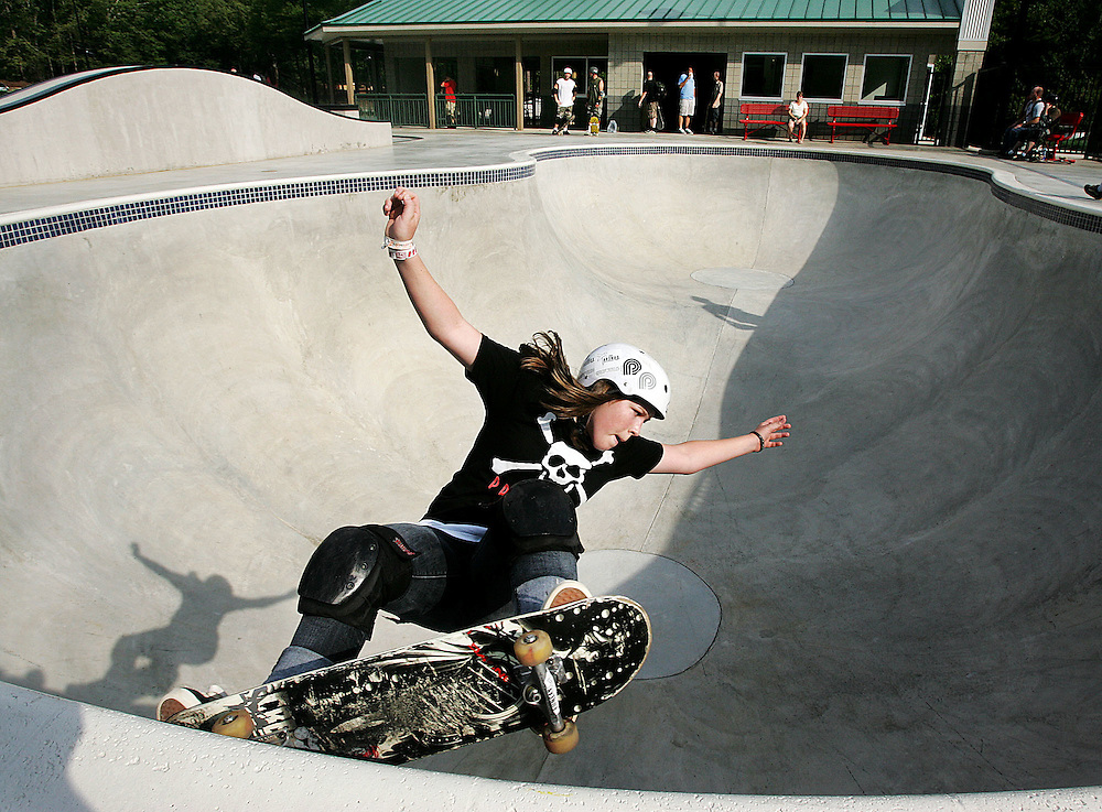 "Fourteen-year-old Brooke Crawford tries out the ""pool"" at the county's new Brook Run skate park."