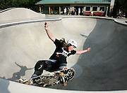 """Fourteen-year-old Brooke Crawford tries out the """"pool"""" at the county's new Brook Run skate park."""