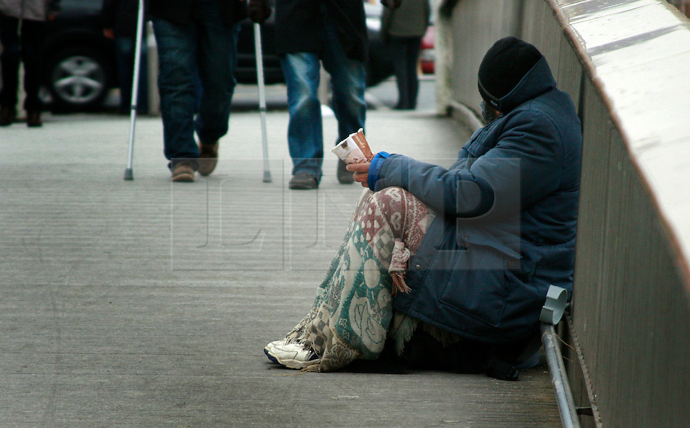 © London News Pictures 12/01/201. A man begging in Dublin. Ireland Minister for Justice Mr Dermot Ahern will present a Bill to the Irish Government within the next few weeks. The new Bill on aggressive begging under the criminal justice bill [public order 2010] will update the current Irish laws on begging that date back as far as the Potato Famine. Under the Bill persons begging accompanied by threats or menace could be jailed or fined up to EUR400, Gardai will also have new powers to move beggars away from Cash Machines. Picture credit should read Simon Lamrock/LNP