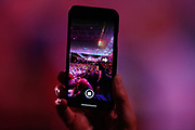 Darts fan takes a photo on his mobile phone during the World Darts Championships 2018 at Alexandra Palace, London, United Kingdom on 21 December 2018.