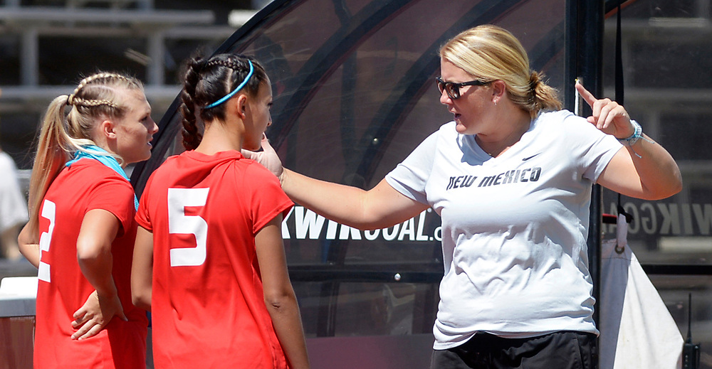 gbs091717p/SPORTS -- UNM soccer coach Heather Dyche discusses strategy with Jessica Nelson, 2, and Isabella Jimenez, 5, on the sidelines during the game against Northern Arizona at the UNM Soccer Complex on Sunday, September 17, 2017.(Greg Sorber/Albuquerque Journal)