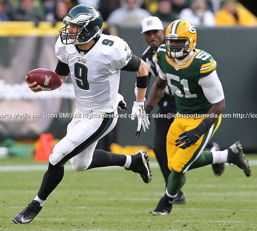 Nov. 10, 2013 - Green Bay, WI, USA - Quarterback Nick Foles of the Philadelphia Eagles scrambles for yardage against the Green Bay Packers during the third quarter at Lambeau Field in Green Bay, Wis., on Sunday, Nov. 10, 2013. The Eagles beat the Packers, 27-13