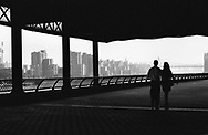 Strolling along the East River esplanade at Carl Schurz Park, New York City.
