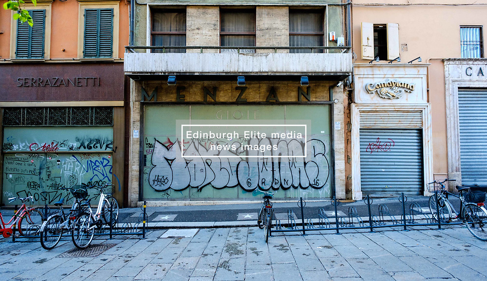 Shuttered up closed shop with graphiti, Bologna, Italy<br /> <br /> (c) Andrew Wilson | Edinburgh Elite media