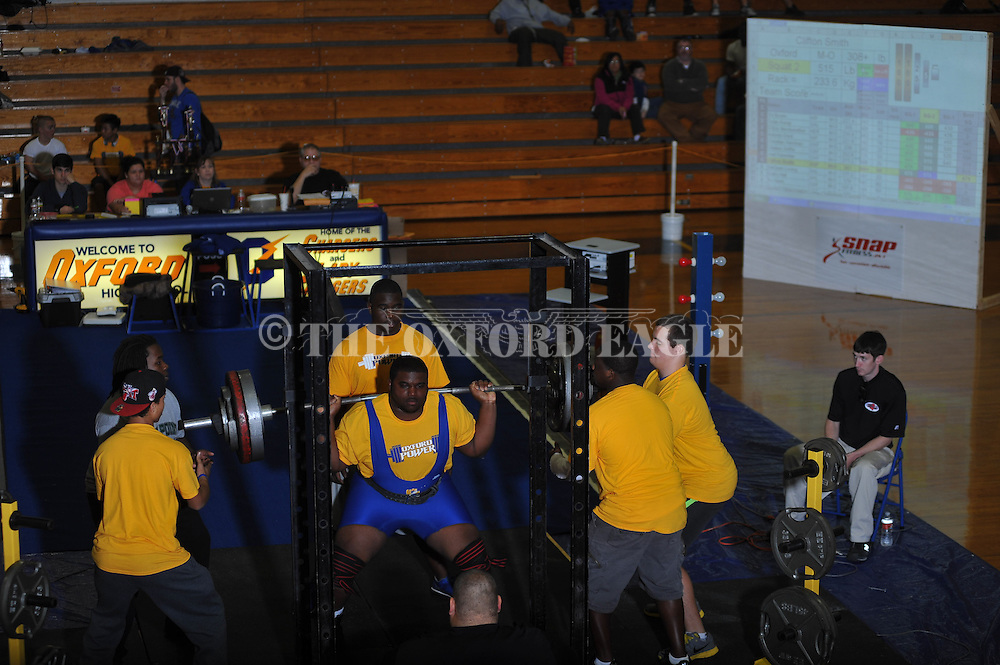 Clifton Smith squats during Class 5A Region weightlifting competition at Oxford High School in Oxford, Miss. on Saturday, February 9, 2013.