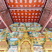 The painted walls and ceiling at Wat Phonxay Sanasongkham in Luang Prabang, Laos.