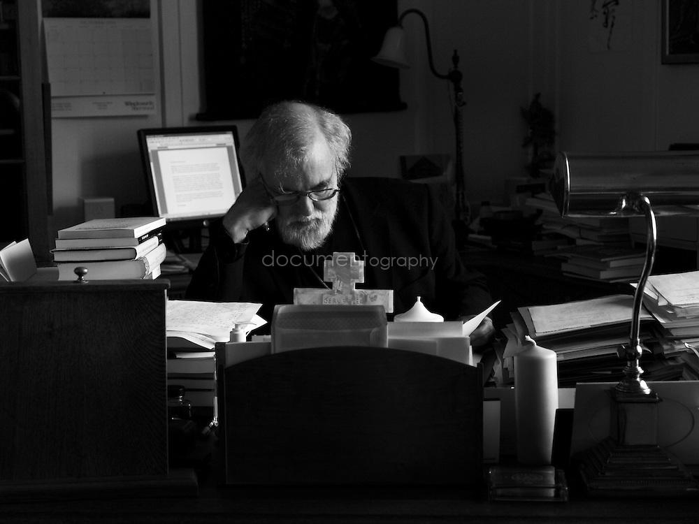 The Archbishop of Canterbury, Rowan Williams in his study at Lambeth Palace, London..OLYMPUS DIGITAL CAMERA