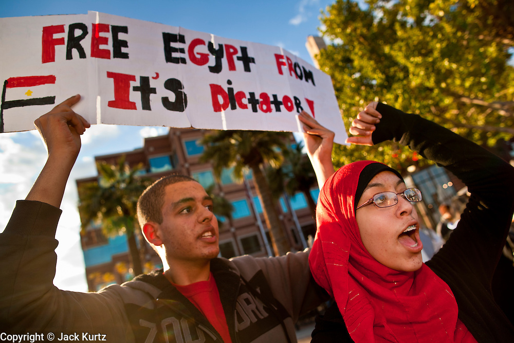 31 JANUARY 2011 - TEMPE, AZ: Egyptians and Arab Americans in Tempe, AZ, demonstrate in support of democracy in Egypt Monday. About 200 people marched through central Tempe, AZ, near the Arizona State University campus Monday afternoon. The rally was organized by the Arab American Association of Arizona in solidarity with the ongoing pro-democracy rallies and demonstrations in Egypt and other Arab countries.    Photo by Jack Kurtz