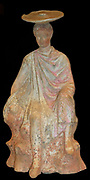 Terracotta figure of a young male sitting on a rock. From Boeotia 300BC. Said to be from Tanagra.   The colours are well preserved.