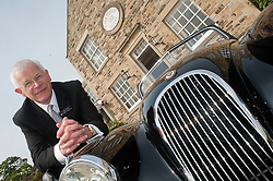 Hatfields Jaguar Ride and Drive event at the Cavendish Hotel Baslow Derbyshire Hatfields Sheffield Dealer Principal Andrew Jeffrey with an original XK which was sold by Hatfields in the 1950's..5th May 2011.Images © Paul David Drabble