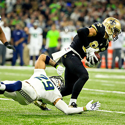 Oct 30, 2016; New Orleans, LA, USA; New Orleans Saints tight end Coby Fleener (82) breaks a tackle by Seattle Seahawks free safety Earl Thomas (29) during the first quarter of a game at the Mercedes-Benz Superdome. Mandatory Credit: Derick E. Hingle-USA TODAY Sports