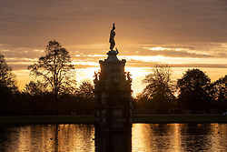 © Licensed to London News Pictures. 03/11/2018. London, UK. Birds rest in the Diana Fountain at sunrise in Bushy Park, south west London. The remains of hurricane Oscar are expected affect parts of the UK overnight bringing high winds and rain. Photo credit: Peter Macdiarmid/LNP