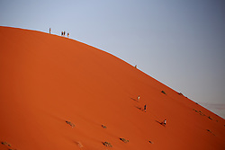 NAMIBIA SOSSUSVLEI 20APR14 - Tourists ascend Dune 45 in Sossusvlei, Namibia.<br /> <br /> Its name comes from the fact that it is at the 45th kilometre of the road that connects the Sesriem gate and Sossusvlei. Standing over 170m, it is composed of 5 million year old sand that is detritus accumulated by the Orange River from the Kalahari Desert and then blown here.<br /> <br /> jre/Photo by Jiri Rezac<br /> <br /> &copy; Jiri Rezac 2014
