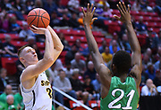 SAN DIEGO, CA - MARCH 16:  Rauno Nurger #20 of the Wichita State Shockers shoots against Darius George #21 of the Marshall Thundering Herd during a first round game of the Men's NCAA Basketball Tournament at Viejas Arena in San Diego, California. Marshall won 81-75.  (Photo by Sam Wasson)