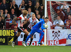 Adrian of West Ham United is interfered with by Danny Wright of Cheltenham Town as he throws out - Mandatory by-line: Paul Roberts/JMP - 23/08/2017 - FOOTBALL - LCI Rail Stadium - Cheltenham, England - Cheltenham Town v West Ham United - Carabao Cup