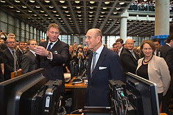 The Duke of Edinburgh is shown around the trading floors at Lloyds of London.<br /> HM The Queen and the Duke of Edinburgh visit  Lloyd's of London, in the City of London, United Kingdom. Thursday, 27th March 2014. Picture by Ben Stevens / i-Images