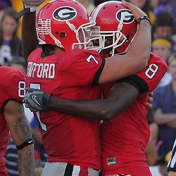 25 October 2008:  Georgia quarterback Matthew Stafford (7) congratulates teammate and wide receiver AJ Green (8) following a touchdown catch during the Georgia Bulldogs 52-38 victory over the LSU Tigers at Tiger Stadium in Baton Rouge, LA.