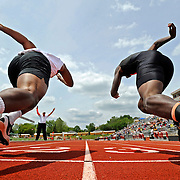 Kris Wilson/News Tribune<br /> Sprinters, including Jefferson City's Elijah Pittman, center left, fire out of the blocks at the start of the boys' 100-meter dash final during the Class 4, District 5 track and field championships at Adkins Stadium.