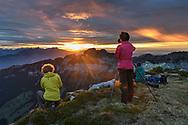 Photographers and sunset over the Sigriswilergrat, Niederhorn, Interlaken, Berne, Switzerland