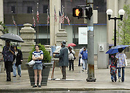 Pedestrians deal with the heavy rain and threats of severe weather in downtown Dayton, Wednesday, June 4, 2008.