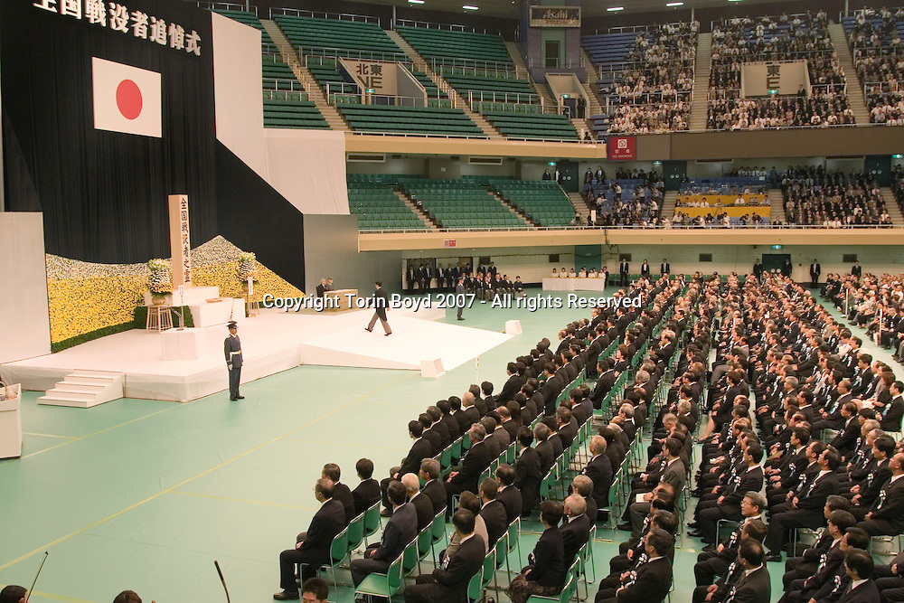 Japanese Prime Minister Shinzo Abe is seen here entering the stage to pay his respects in front Emperor Akihito and Empress Michiko during the national memorial service for war dead held annually at the Nippon Budokan hall in Tokyo on August 15, the anniversary of the end of World War II (for Japan). In addition to the Emperor and Prime Minister, several high ranking Japanese politicians, military officials, and most importantly Japanese WW II veterans and bereaved family members were in attendance. This service remembers the 3.1 million Japanese who died during the war including both soldiers and civilians. According to government organizers, 4,776 family members attended the memorial this year on the 62nd anniversary of the end of WW II, August 15, 2007.