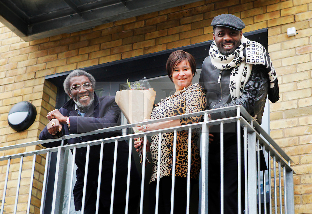 © under license to London News Pictures.  Actor Idris Elba with his father Winston Elba(far left) and new resident Pat Benjamin (middle) during the opening of Elba House, a new social housing development in Andre St, Hackney on 14th january 2011. Elba House is named after the star of The Wire and Luther. Photo credit should read: Olivia Harris/ London News Pictures