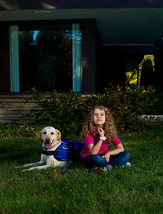 Esme´ Thuemling stands for a portrait with her dog Kaiya at their home in Bayside Wisconsin October 5, 2011. Darren Hauck