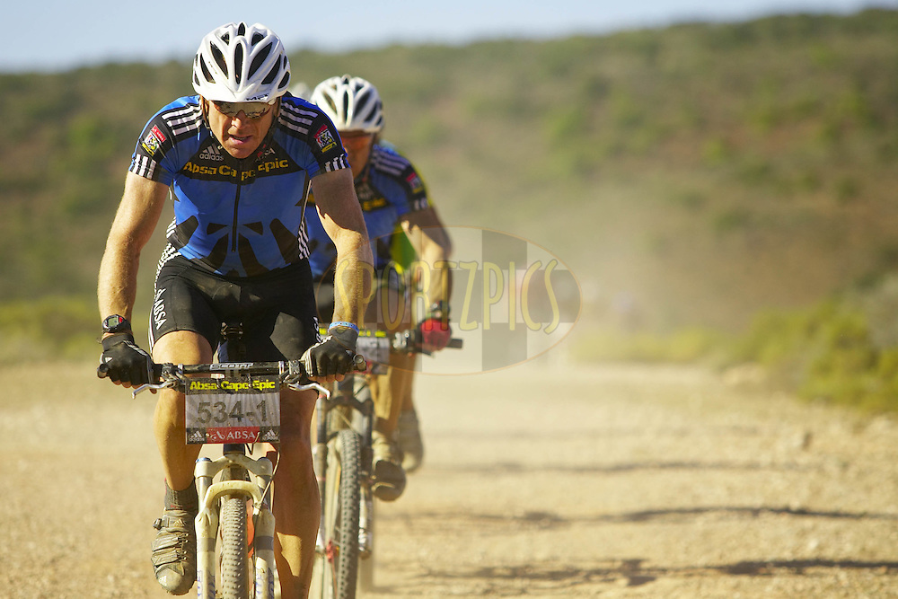 WESTERN CAPE, SOUTH AFRICA -  30 March 2008, Masters category leaders Doug Brown and Barti Bucher of Absa Masters during stage two of the 2008 Absa Cape Epic Mountain Bike stage race from Saasveld Campus Nelson Mandela Metropolitan University in George to Calitzdorp Spa, Calitzdorp in the Western Cape, South Africa..Photo by Gary Perkin/SPORTZPICS