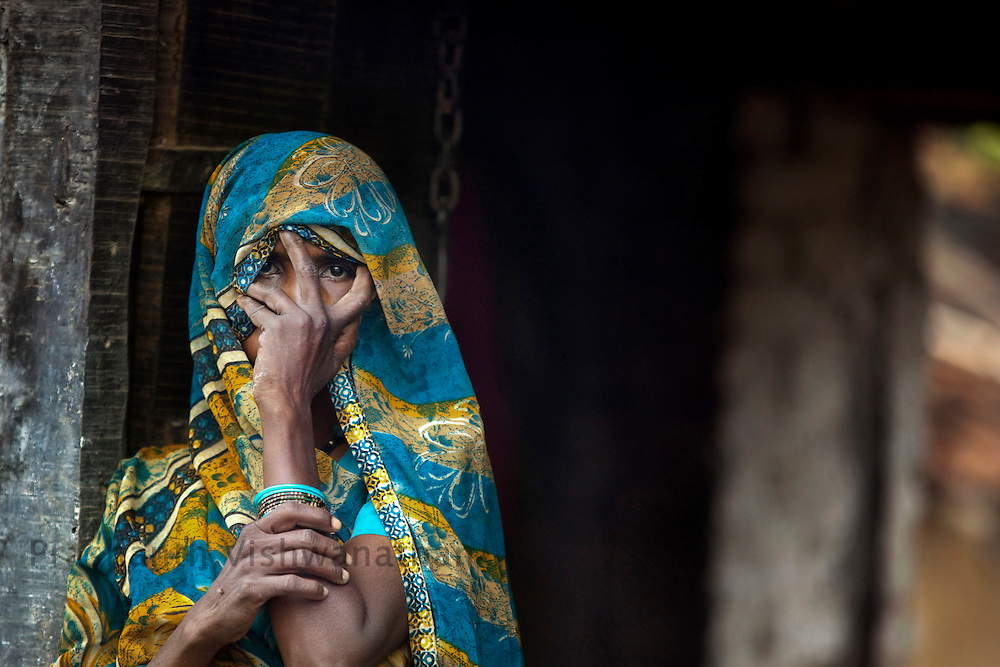 """Women look through their veil as the """"Pardha"""" system is very prevelant in the Bundelkhand area in  Chandauli in Mahoba district, Uttar Pradesh, India, on Thursday September 10, 2009. Photographer: Prashanth Vishwanathan/Action Aid"""