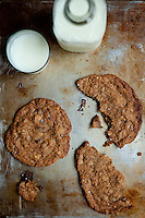Whole Wheat Chocolate Chip Cookies with Black Walnuts on a tray with a bottle of milk and a glass of milk. Photograph by St. Louis Food Photographer Jonathan Gayman for the Shoot to Cook food blog.