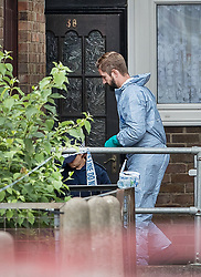 © Licensed to London News Pictures. 05/09/2017. London, UK. Police conduct a search at the entrance to a property near where two teenage boys were shot and injured yesterday in Forest Gate, Newham. Police were called at 15:10 hrs and found two teenage boys - aged 14  and 17 with gunshot injuries. Photo credit: Peter Macdiarmid/LNP
