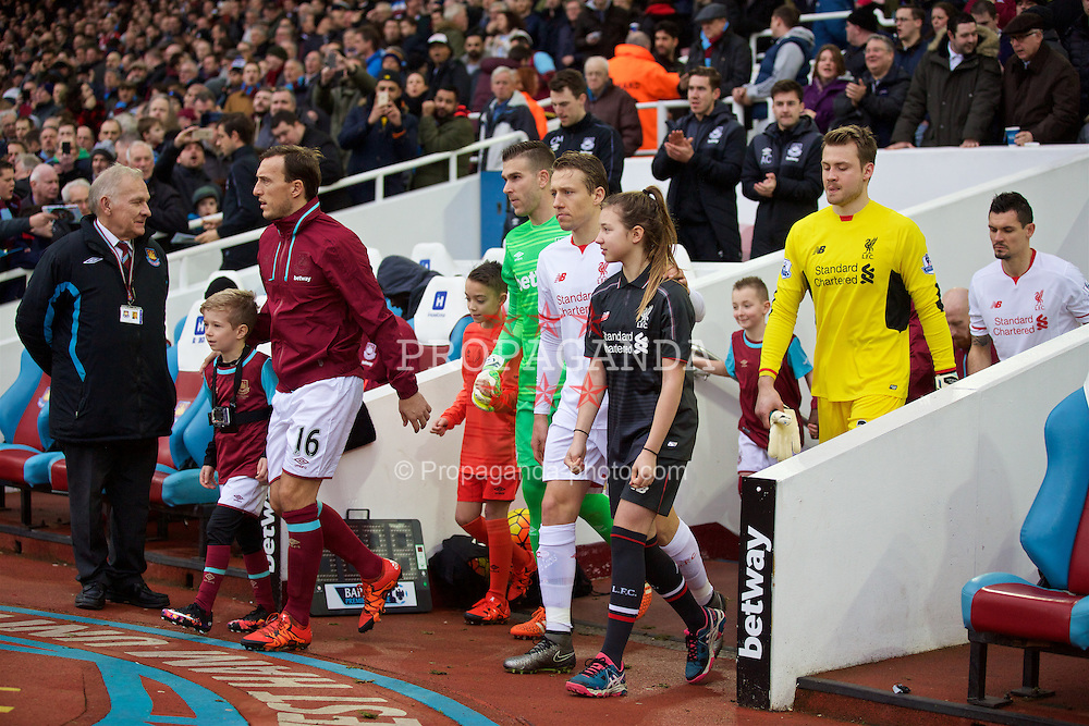 LONDON, ENGLAND - Saturday, January 2, 2016: Liverpool's captain Lucas Leiva leads his side out to face West Ham United during the Premier League match at Upton Park. (Pic by David Rawcliffe/Propaganda)