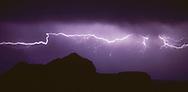 Cloud-to-cloud lightning over the Mesa at Otowi Ruin, © 1983 David A. Ponton