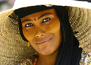 Yemen, Taiz, Jebel Saber, portrait of a woman with painted eyebrows. These women do not cover their faces when in public. They wear a vegetable paste to protect their skin from sun damage. This paste gives their faces a<br />